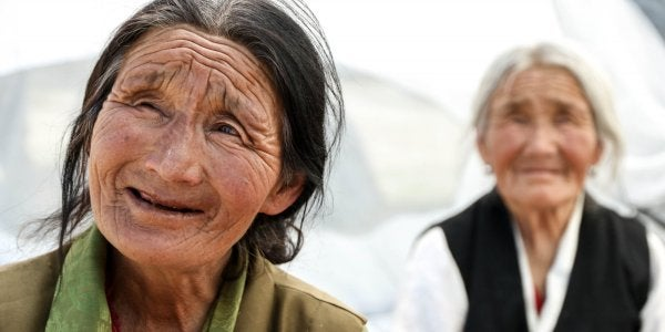 A photo of two elderly Indian women