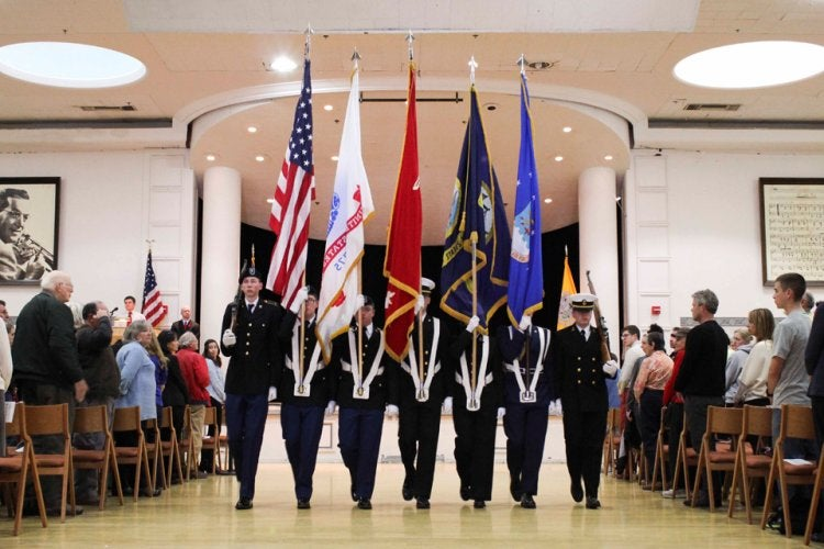 ROTC Color Guard presents colors at the UMC Veterans Day ceremony.
