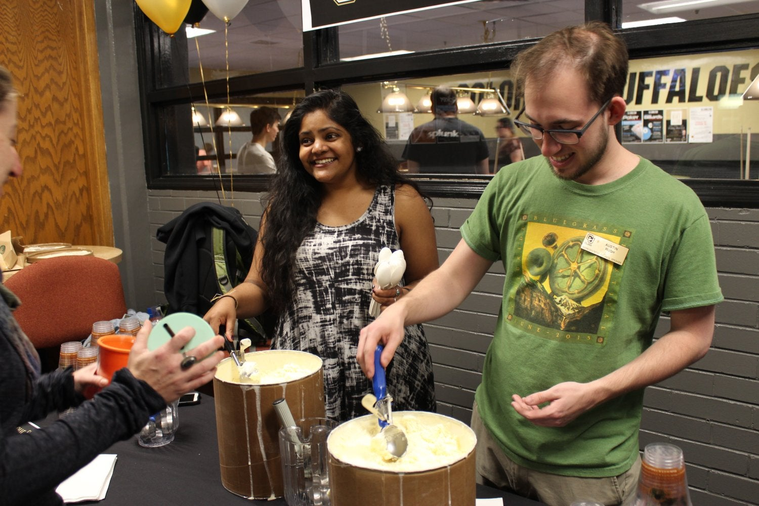 Students serve ice cream floats at First Friday Buff Club