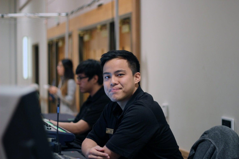 A student employee on the UMC audio visual team