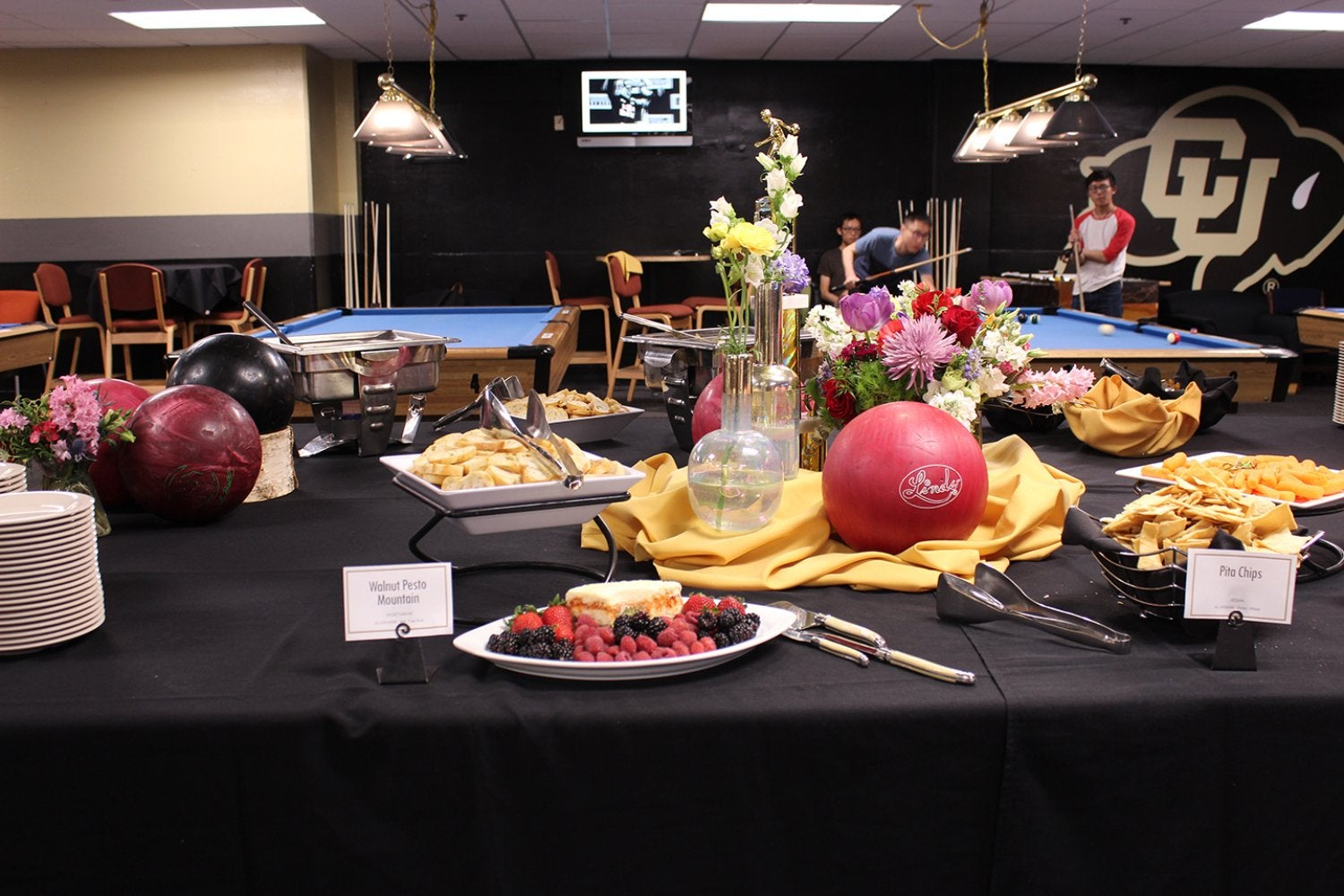A table with food and flowers set out for the Art Walk during First Friday Buff Club