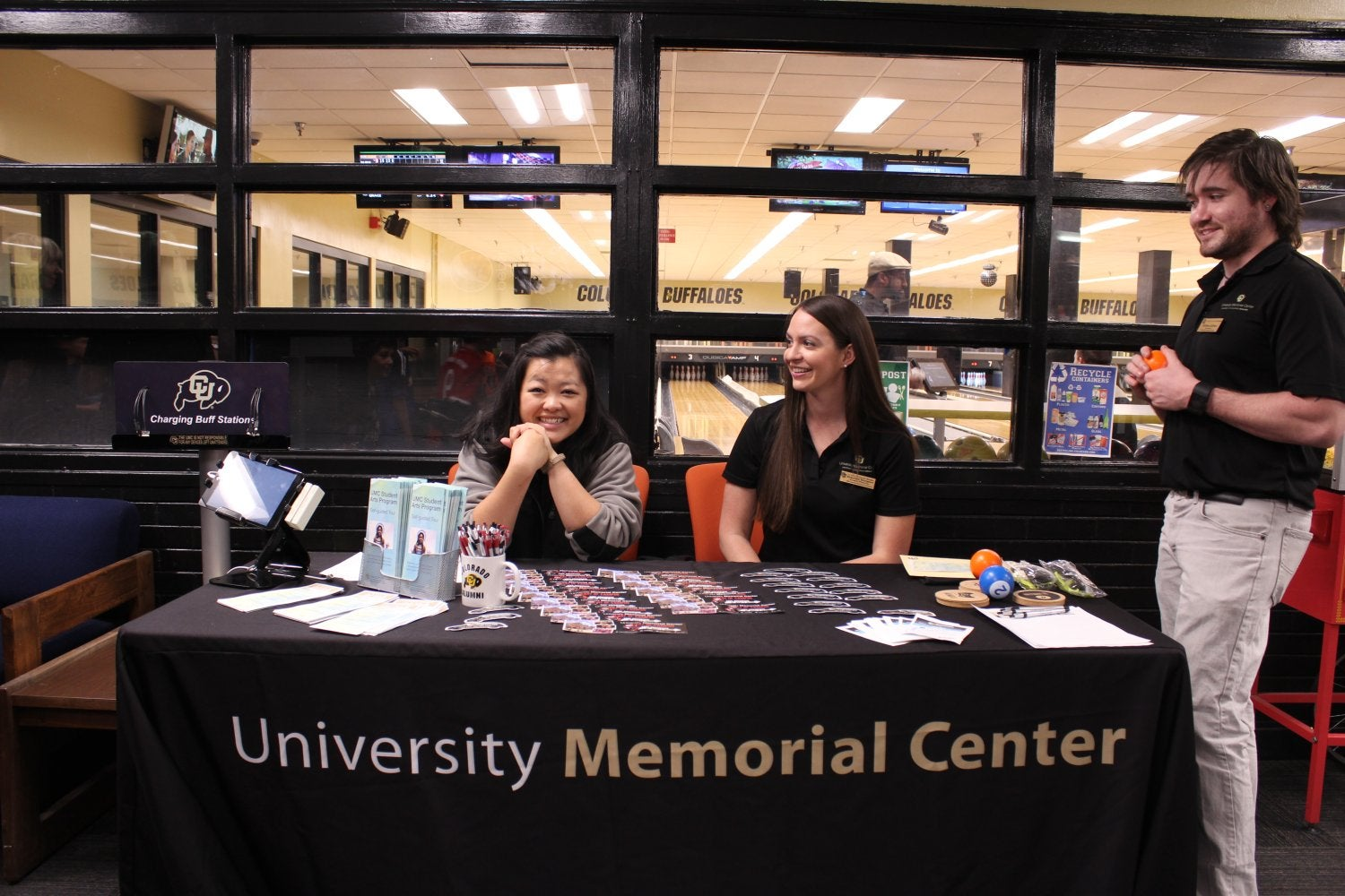 UMC staff members greet guests from the Welcome Table