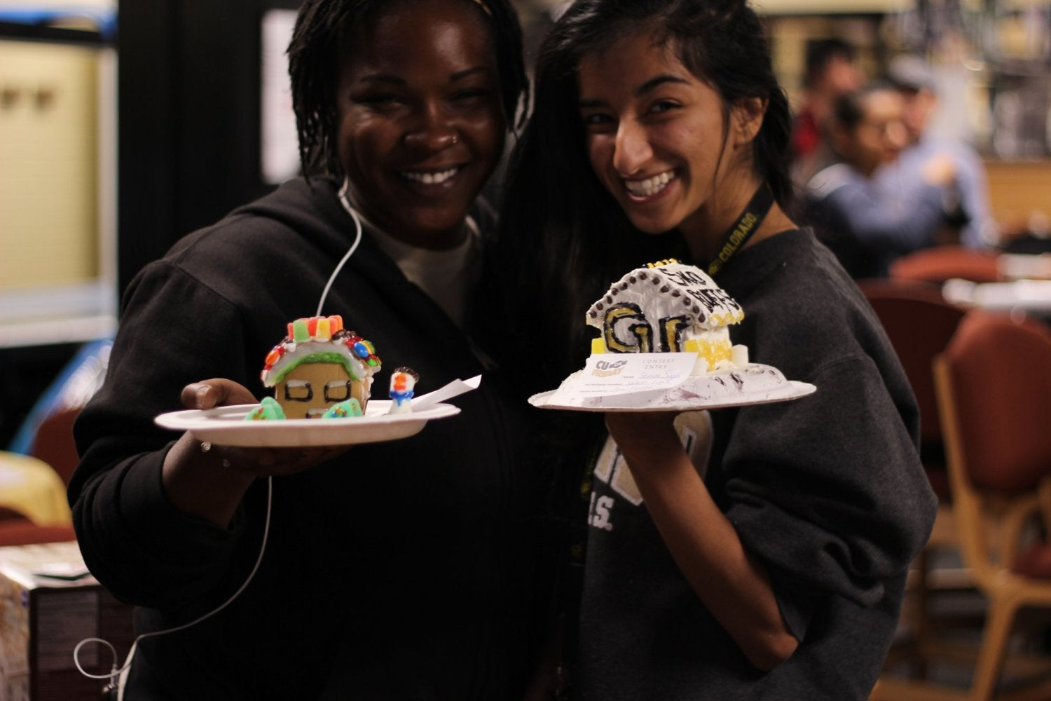 Attendees build gingerbread houses at CU on Friday