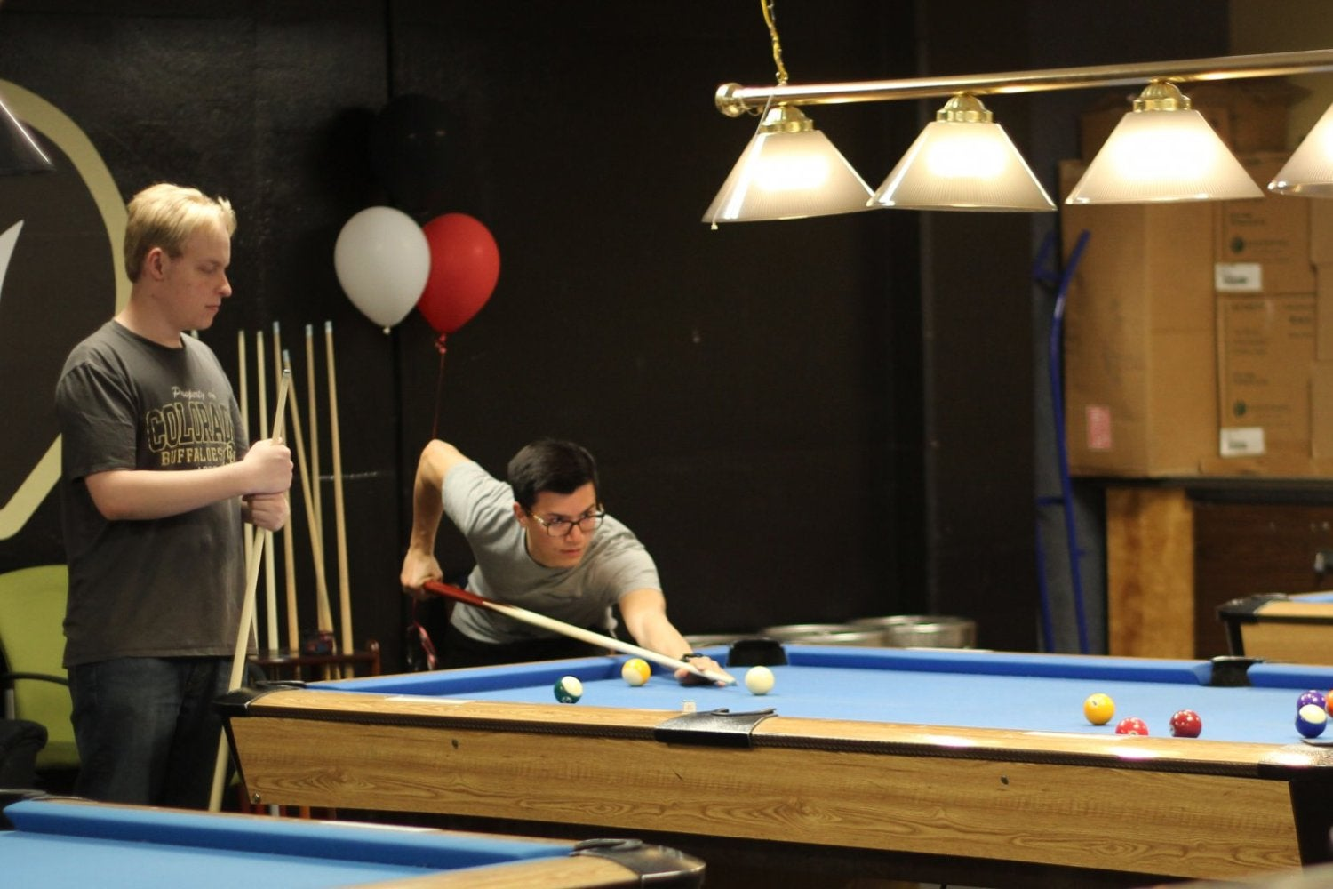 Students playing billiards at The Connection
