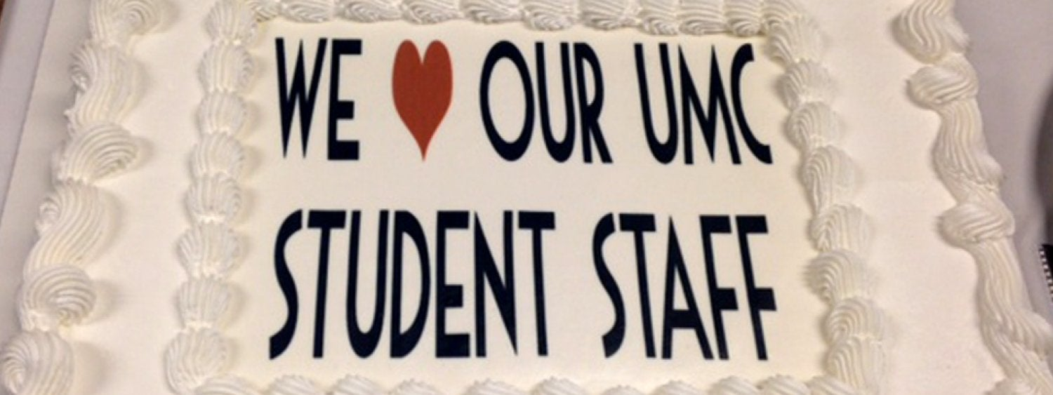 "A large cake with the words ""We love our student staff."""