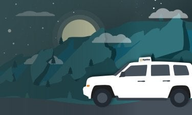 Illustration of a white car on a road at night in front of mountains