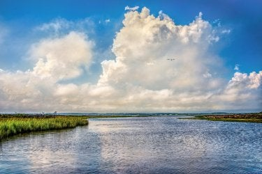 """""""Clouds Over Sinepexuent Bay"""" by David Goudy"""