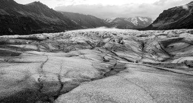 A black-and-white photo of a glacier