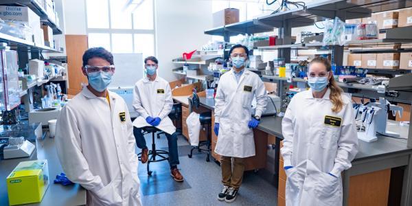 darwin biosciences team in lab