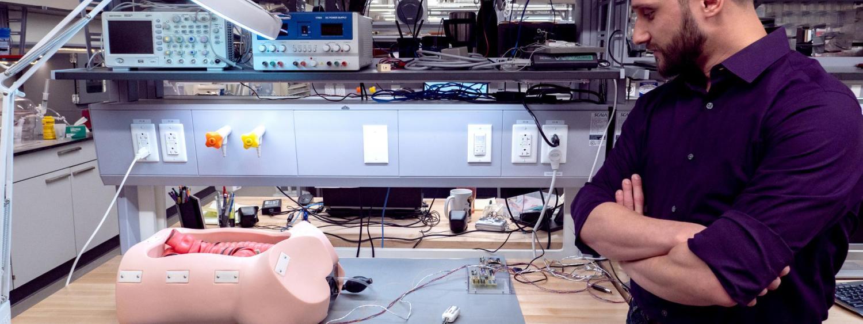 grad student with colonoscopy prototype