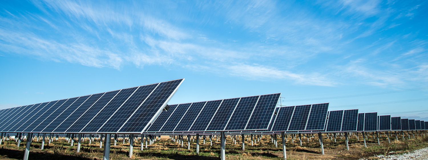 Solar panels in front of a blue sky