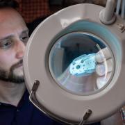 gregory formosa inspects a colonoscopy robot