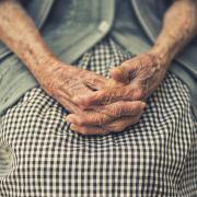elderly lady's hands in lap