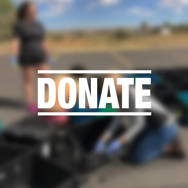 """blurry group volunteer work photo with """"donate"""" overlayed"""
