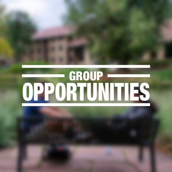 """White text reading """"group opportunities"""" over a faded photo of two students sitting together on campus"""