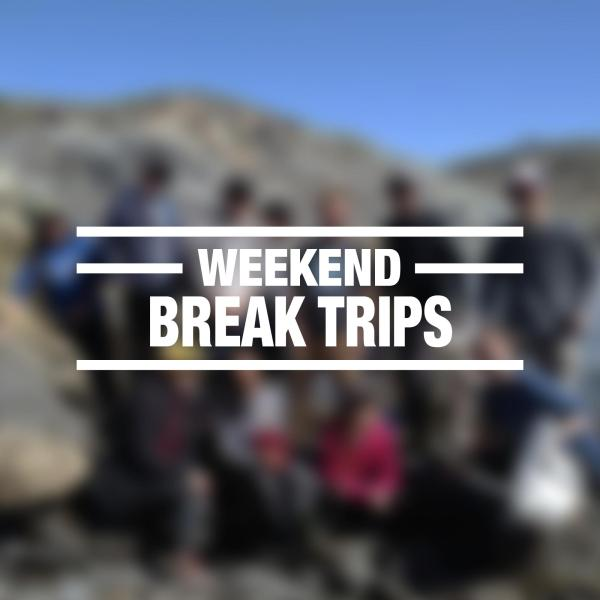 """blurry group photo with """"weekend break trips"""" overlayed"""