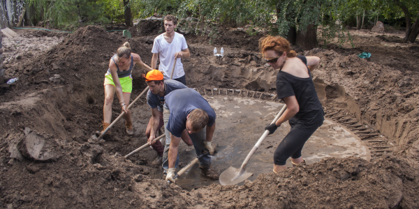 Students digging at a service site