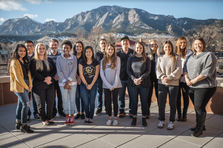 Volunteer Resource Center Staff posing on the UMC in front of the flatirons
