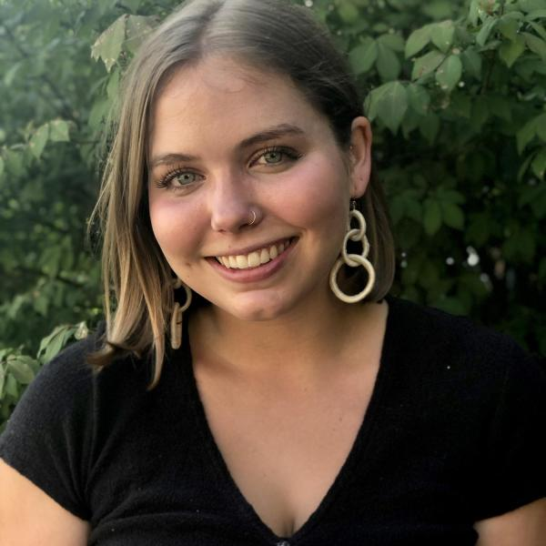 Photo of a woman in a black shirt