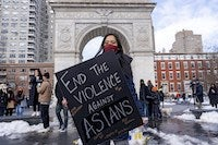 A woman holds a sign at the End The Violence Towards Asians rally in Washington Square Park on Feb. 20, 2021, in New York.Ron Adar/SOPA Images / Sipa USA via AP file