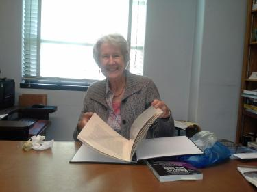 Dr. Jaggar receiving a book put together by her advisees for her birthday several years ago